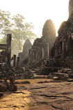 Angkor, Cambodia. Khmer Bayon temple sunrise. The Unesco world heritage Khmer archaeological site of Angkor, Siem Reap, Cambodia. Bayon Buddhist temple ruins at stock photo