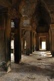 Angkor, Cambodia. Stone corridor and pillars Royalty Free Stock Image