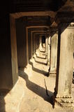 Angkor, Cambodia. Stone corridor and pillars Royalty Free Stock Photos