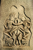 Angkor Wat wall carvings. Detailed carving in one of the Angkor temples in Cambodia royalty free stock photography