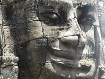 Angkor face. Face from Bayon in Angkor complex, Cambodia royalty free stock image