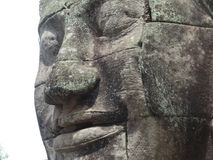 Angkor face. Face from Bayon in Angkor complex, Cambodia royalty free stock photo