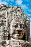 Angkor Faces. The carved face of  Buddha in Bayon Temple, Angkor Wat Royalty Free Stock Photography