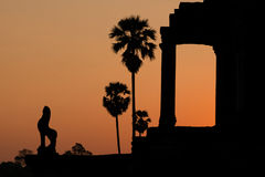Angkor silhouette. Silhouette of Angkor Wat ruins during the sunrise Royalty Free Stock Photography