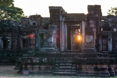 Angkor style temples and ancient khmer ruins at Phimai, travel destination in East Thailand. Backlight sunburst sun star. Stock Photos