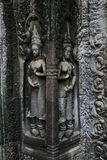 Angkor Temple Art. A view of the beautiful idols carved in the walls of the Angkor temple in Cambodia Stock Photos