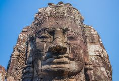 The carved faces of Angkor Thom, Cambodia royalty free stock photo