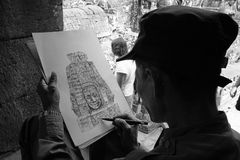 Angkor Thom drawer. Local artist drawing a section of the Angkor Thom temple in Cambodia, in black and white Stock Photos