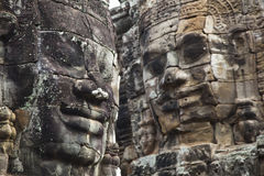 Angkor Thom's Smiling Faces. Two of the carved smiling faces at Cambodia's Angkor Thom temple complex Stock Photography