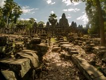 Angkor thom temple in archaeological park with monks stock photography