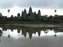 Angkor Wat. The tower s of Angkor Wat reflected in the water of the small lake built in front of the site Stock Image