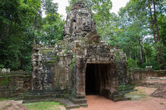 Angkor Wat. Vintage temple entrance and forest in Angkor Wat (Siem Reap, Cambodia royalty free stock photos