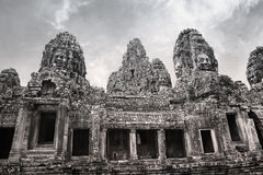 Angkor Wat, ancient heritage, Siam Reap, Cambodia. Faces of Buddha are carved into the stone exteriorAngkor Wat, ancient heritage site at Siam Reap, Cambodia of Stock Photo