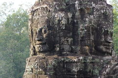 Massive stone faces of Bayon stock photography