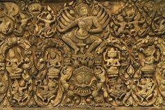Angkor Wat art of ancient Hindu god stone. Angkor Wat wonder of the world ancient stone art of ancient Hindu god stone background royalty free stock photography