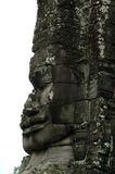 Angkor Wat - Bayon - Broken Smiling Face. Combodia, Angkor Wat area, the Bayon temple, a broken face that look over the world for over a 1000 years Stock Photo
