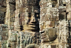 Angkor Wat Bayon stone sculpcute in the morning sun light Royalty Free Stock Photography