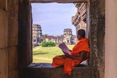Angkor Wat, Cambodia - December 7, 2016: Monk reading Royalty Free Stock Photos