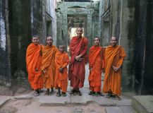 A group of Buddhist child monks with their elder in the temple stock image