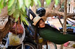 ANGKOR WAT - CAMBODIA - FEBRUARY 5 2015 Young woman lying in a hammock in Cambodia Angkor Wat Stock Photo