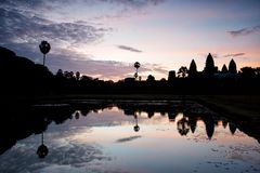 Angkor Wat in Cambodia and reflection in water Stock Photos