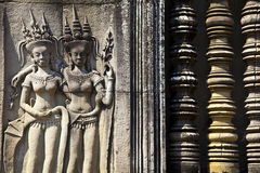 Angkor Wat Detail of Woman and Balustrades. A detail of two carved women besides carved balustrades at Cambodia's Angkor Wat temple complex Stock Images