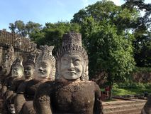 Angkor Wat faces. Statues of gods, asian ancient city,old khmer religion. Angkor Wat faces. Statues of gods, asian ancient city,old khmer temple in jungle. Lost stock image