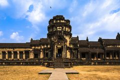 Angkor Wat and flying bird. Under blue sky Royalty Free Stock Image