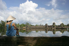 Angkor Wat and girl Stock Images