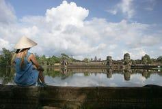 Angkor Wat and girl. Girl looking at Angkor Wat in Cambodia Stock Images
