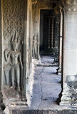 Angkor wat hallway. A view down a hallway at Cambodia's Angkor Wat temple complex with detailing Stock Image