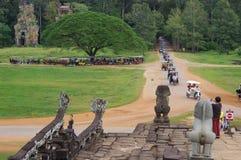 Returning tuk tuks at city of Angkor Thom stock photography