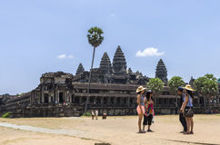 Angkor Wat the largest religious monument in the world. Angkor, Siem Reap, Cambodia - April 14, 2013 : Tourists in front of the  Angkor Wat temple at Cambodia Royalty Free Stock Image
