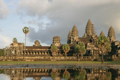 Angkor Wat and lotuses. Ancient Angkor Wat surrounded by moat with lotuses Stock Photo