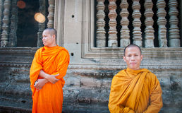 Angkor Wat Monks. Friendly monks at Angkor Wat chat with tourists Royalty Free Stock Images