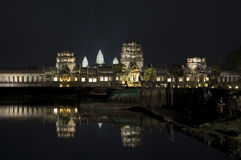 Angkor Wat at Night. The temple of Angkor Wat in Cambodia at night time reflecting in a lake Stock Image