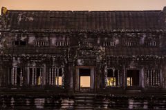 Angkor Wat Outer wall against orange sunrise Stock Photos