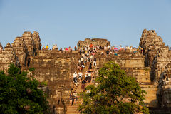 Angkor Wat from Phnom Bakheng at sunset, Cambodia. Angkor Wat, Cambodia - March 18, 2011 : Tourists sitting at the top ot a temple to see the marvelous sunset Stock Photo