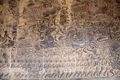 Angkor Wat. Reliefs at Angkor Wat, Angkor, Siem Reap, Cambodia. The inner wall of the outer gallery bear a series of scenes depicting episodes from the Hindu stock photo