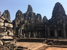 Angkor Wat in Siem Reap, Cambodia. Ancient ruins of Bayon Khmer stone temple. In jungle forest. Place of worship and popular tourist travel destination in Asia Royalty Free Stock Images
