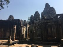 Angkor Wat in Siem Reap, Cambodia. Ancient ruins of Bayon Khmer stone temple. In jungle forest. Place of worship and popular tourist travel destination in Asia Stock Image