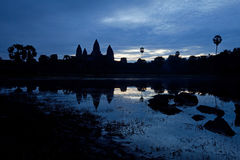 Angkor Wat Silhouette at Dawn against Dark Blue Sky Stock Photos