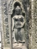 Angkor Wat stone statue. In the centre of the walls stood a statue.  The upright stones are the vestige of ancient religions Stock Image