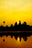 Angkor Wat at sunrise across the lake, reflected in water Royalty Free Stock Image
