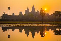 Angkor Wat at Sunrise. Is an iconic image. The beauty of these ruins are symbolic of Cambodia. The nearest city, Siem Reap, caters to travelers who make this Stock Photo
