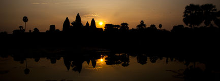 Angkor Wat Sunrise. At sunrise, the main temple structure at Angkor Wat is reflected in the lake Stock Photo