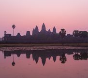 Angkor Wat at Sunrise. Angkor Wat reflection at sunrise is an iconic image. The beauty of these ancient ruins are symbolic of Cambodia. Siem Reap, caters to Stock Photography