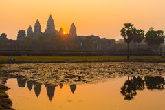 Angkor Wat at Sunrise. Angkor Wat reflection at sunrise is an iconic image. The beauty of these ancient ruins are symbolic of Cambodia. Siem Reap, caters to stock images