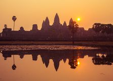 Angkor Wat at Sunrise. Angkor Wat reflection at sunrise is an iconic image. The beauty of these ancient ruins are symbolic of Cambodia. Siem Reap, caters to Royalty Free Stock Photography
