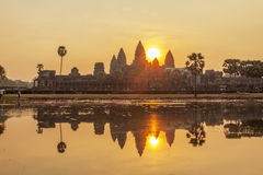 Angkor Wat at sunset, Siem Reap, Cambodia. Angkor Wat at dawn, Siem Reap, Cambodia. The lake in front of the Angkor Wat where tourists commonly stand here to royalty free stock image